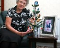 Frances Fearn with the Christmas tree her husband Geoff (shown in pic alongside tree) was given in 1929 - GNS